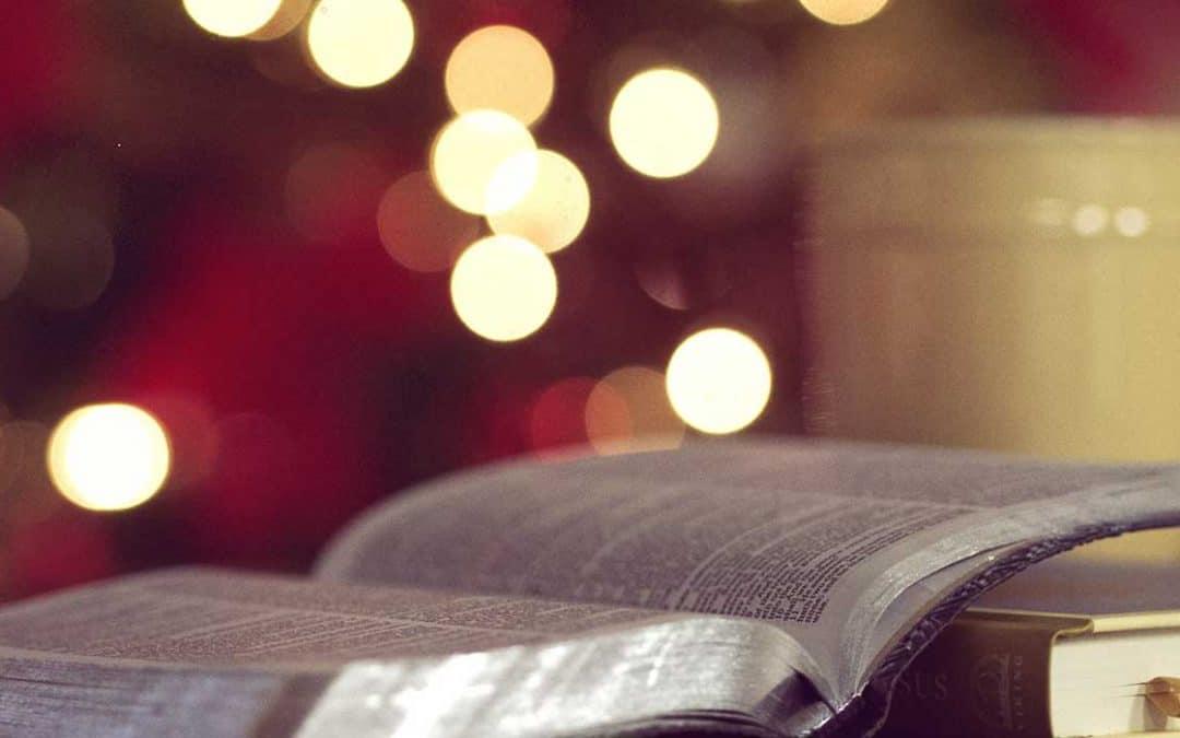 A Bible, mug, and notebook